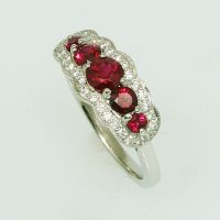A ruby and diamond half hoop ring set in platinum.