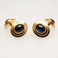 A pair of cabochon sapphire and 18 carat yellow gold cufflinks,