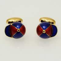 A pair of 18 carat yellow gold jockey cap cufflinks hand enamelled in scarlet and royal blue by Deakin and Francis.