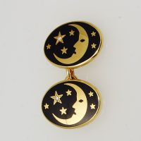 18 carat yellow gold and enamelled cufflinks with a crescent 'man in the moon' and stars on a dark navy blue enamelled ground