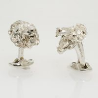 A pair of silver lion mask cufflinks by Deakin and Francis