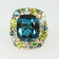 A deep blue topaz and multi-gemstone cluster ring set in 18 carat pink gold by Isabelle Langlois.